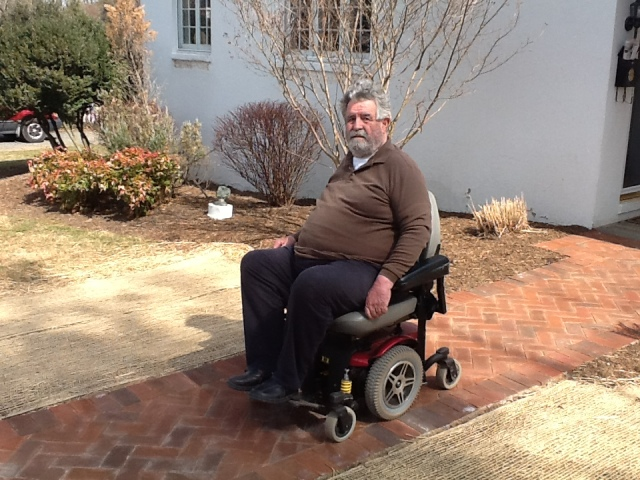 Brown Morton using his motorized wheelchair on his new brick walkway