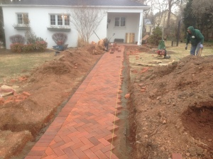 Blake Landscapes staff working on the walkway at Brown Morton's home